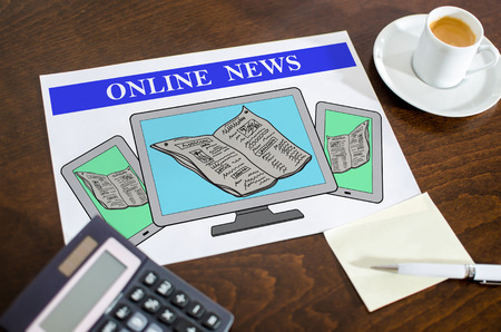 Photo for Online news concept on a paper placed on a desk - Royalty Free Image