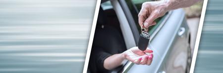 Photo pour Man handing another person automobile keys. panoramic banner - image libre de droit
