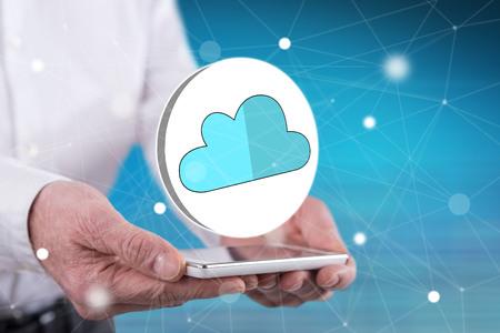 Photo pour Cloud networking concept above a smartphone held by hands - image libre de droit
