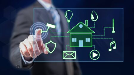 Photo pour Man touching a digital smart home automation concept on a touch screen with his fingers - image libre de droit