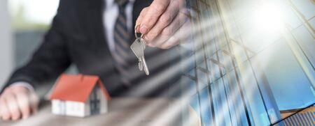 Photo pour Real estate agent holding house keys, concept of home ownership; multiple exposure - image libre de droit