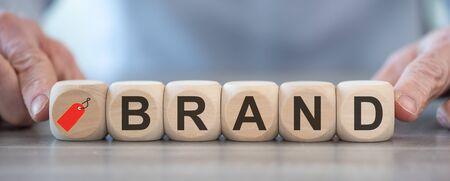Photo pour Concept of brand with wooden cubes - image libre de droit