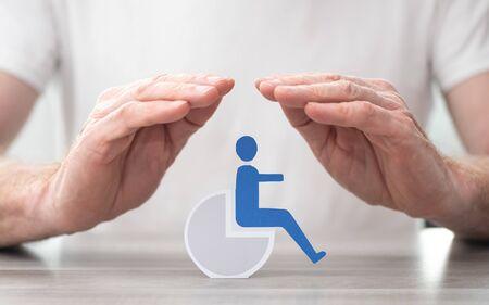 Photo pour Disabled person protected by hands - Concept of disability insurance - image libre de droit