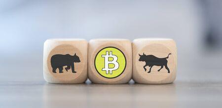 Foto de Bullish and bearish market concept on wooden blocks - Imagen libre de derechos
