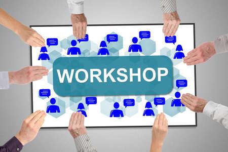 Photo pour Workshop concept on a whiteboard held by hands - image libre de droit