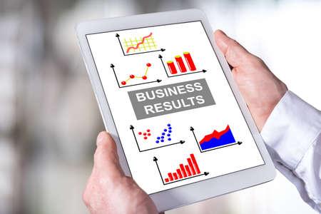 Photo pour Man holding a tablet showing business results concept - image libre de droit