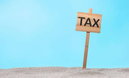 Photo pour Concept of tax on a wooden sign - image libre de droit