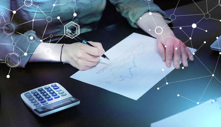 Photo pour Businesswoman analyzing marketing data; light effect - image libre de droit