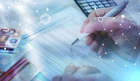 Photo pour Businessman making investment calculations; light effect - image libre de droit