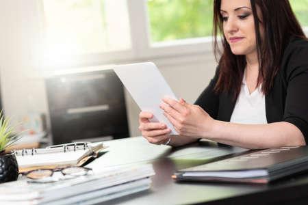Foto de Businesswoman using digital tablet at workplace - Imagen libre de derechos