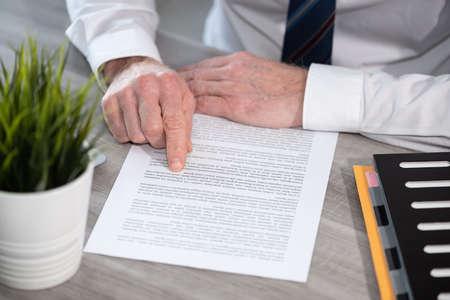 Photo pour Hands of businessman checking document - image libre de droit
