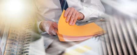 Photo pour Businessman opening folder with paper documents; multiple exposure - image libre de droit
