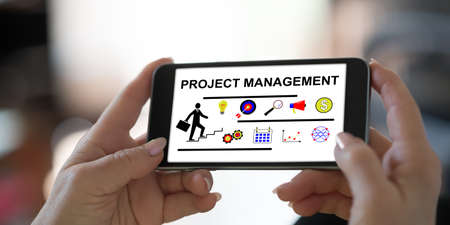 Photo for Hand holding a smartphone with project management concept - Royalty Free Image