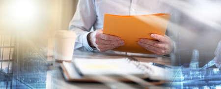 Photo pour Businessman holding a folder at office; multiple exposure - image libre de droit