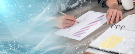 Photo pour Businesswoman analyzing marketing data; panoramic banner - image libre de droit