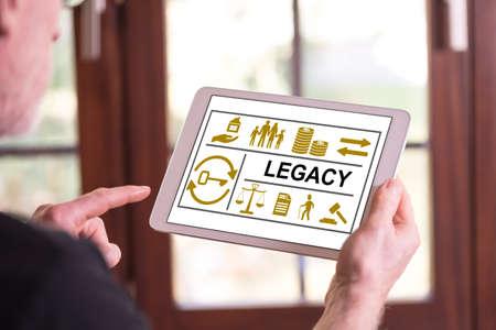 Photo pour Man holding a tablet showing legacy concept - image libre de droit