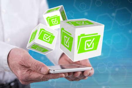Photo pour Document validation concept above a smartphone held by hands - image libre de droit