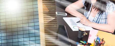 Photo pour Young businesswoman working on documents at office; multiple exposure - image libre de droit