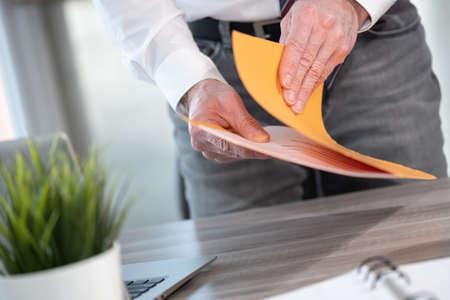 Photo pour Businessman opening folder with paper documents - image libre de droit