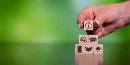 Photo pour Concept of information with icons on wooden cubes - image libre de droit