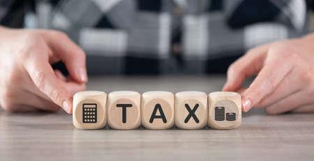 Photo pour Concept of tax on wooden cubes - image libre de droit