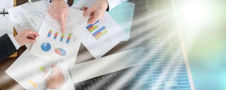 Photo pour Businesspeople having a discussion about financial report at office; multiple exposure - image libre de droit