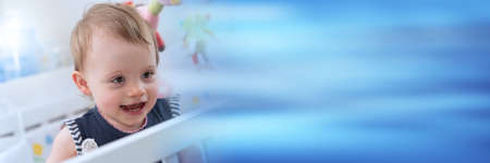 Photo pour Portrait of happy cute baby girl with a beautiful smile; panoramic banner - image libre de droit