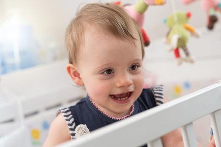 Photo pour Portrait of happy cute baby girl with a beautiful smile - image libre de droit