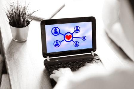 Photo pour Laptop screen displaying an online dating concept - image libre de droit