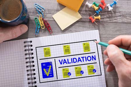 Photo pour Validation concept drawn on a notepad placed on a desk - image libre de droit