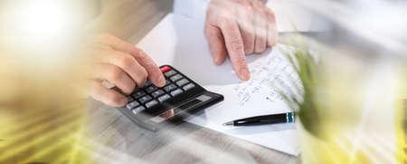 Photo pour Male hands using calculator. concept of finance and economy; multiple exposure - image libre de droit