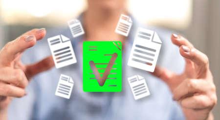 Photo pour Document validation concept between hands of a woman in background - image libre de droit