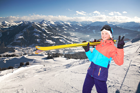 a teenage girl skiing alpin in the mountains