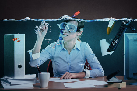 Foto de symbolic picture of a stressed female office worker and for stress at work - Imagen libre de derechos