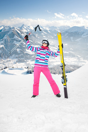 a woman skiing alpin in the mountains