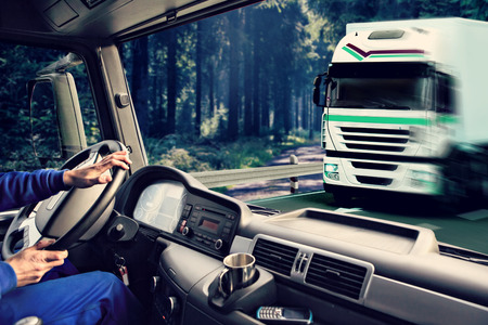 Foto de driver view from the cockpit of a truck on the road - Imagen libre de derechos