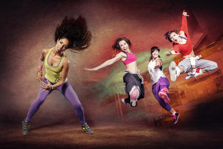 Foto de young woman at fitness exercise or zumba dancing - Imagen libre de derechos
