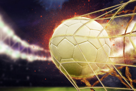 Photo pour symbolic picture for goal with a soccer ball in net - image libre de droit