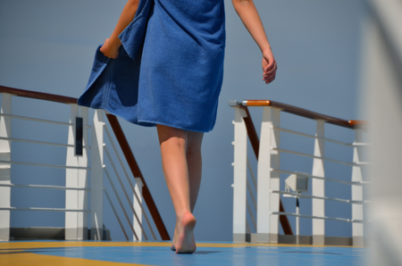young woman with blue towel on a cruise ship