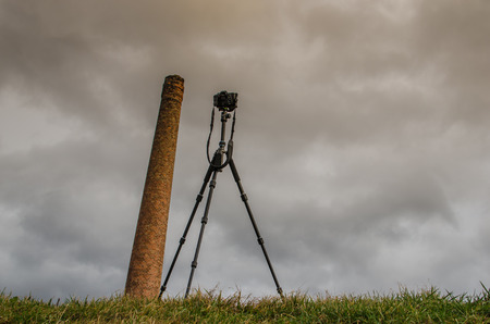 chimney and camera on tripod with equal height