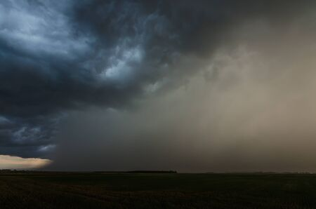 Photo for dark storm clouds with heavy rain in summer - Royalty Free Image