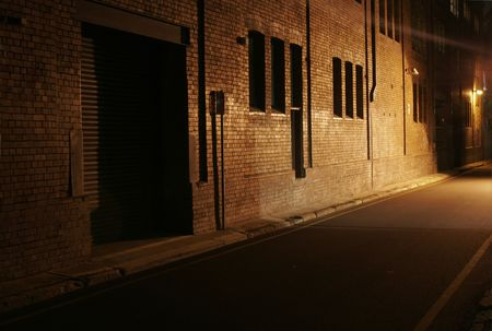 Mysterious Alley - Dark Abandoned Street With Lights Shining On A Brick Wall
