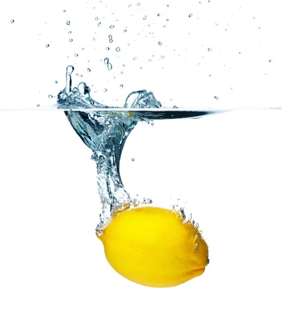 Fresh lemon falling into water  Isolated on white backgroundの写真素材