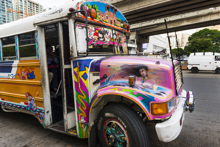 Panama City, Panama - March 18, 2014: Red Devil Bus (Diablo Rojo) in a street of Panama City. Red Devil buses are public transports painted in bright colors and symbols.