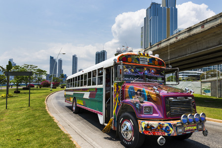 Panama City, Panama - March 17, 2014: Red Devil Bus (Diablo Rojo) in a street of Panama City. Red Devil buses are public transports painted in bright colors and symbols.