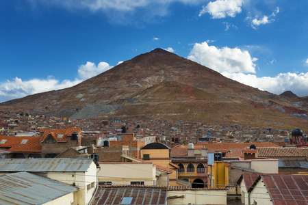 Potosí, Bolivia - November 28, 2013: View of the city of Potosí with the Cerro Rico on the back, in BolÃvia. Potosí is one of the highest cities in the world and it was the major supply of silver for Spain During the colonial era.