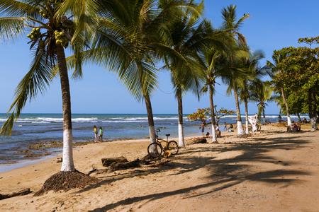 Puerto Viejo de Talamanca, Costa Rica - March 22, 2014: People at the beach in Puerto Viejo de Talamanca in Costa Rica