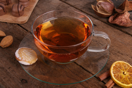 Cup of tea with dry orange