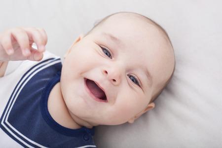 Foto de Portrait of cute cheerful baby - Imagen libre de derechos