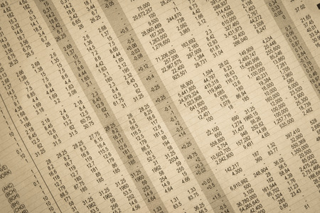 closeup stock and financial on newspaper